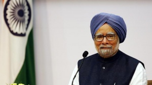 Manmohan Singh smiles during a news conference in New Delhi January 3, 2014. REUTERS/Harish Tyagi/Pool/Files