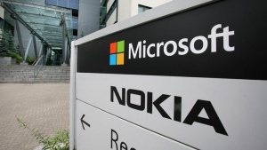 A view of Microsoft and Nokia signs in Peltola, Oulu July 16, 2014. Microsoft Corp said on Thursday it would cut up to 18,000 jobs, or about 14 percent of its workforce, as it halves the size of its recent Nokia acquisition and trims down other operations. REUTERS/Markku Ruottinen/Lehtikuva