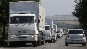 Trucks of a Russian convoy carrying humanitarian aid for Ukraine, drive in the direction of the Ukrainian border near the town of Donetsk, in Russia's Rostov Region, August 22, 2014. REUTERS/Alexander Demianchuk