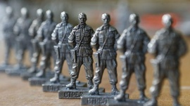 "Figurines of former pro-Russian separatist commander Igor Strelkov from the collection entitled ""Toy Soldiers of Novorossiya"" are on display at a workshop in Moscow August 29, 2014.  REUTERS/Sergei Karpukhin"