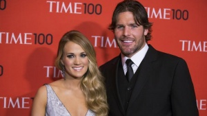 Honoree and singer Carrie Underwood arrives with her husband Mike Fisher at the Time 100 gala celebrating the magazine's naming of the 100 most influential people in the world for the past year, in New York April 29, 2014. REUTERS/Lucas Jackson/Files