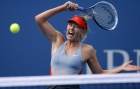 Maria Sharapova of Russia hits a return to Caroline Wozniacki of Denmark during their match at the 2014 U.S. Open tennis tournament in New York, August 31, 2014. REUTERS/Ray Stubblebine