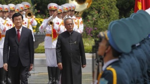 India's President Pranab Mukherjee (back, R) reviews a guard of honour with Vietnamese counterpart Truong Tan Sang during a welcoming ceremony at the Presidential Palace in Hanoi September 15, 2014. REUTERS/Kham