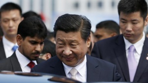 China's President Xi Jinping (C) leaves after the launch ceremony of a $1.5 billion project to build a port city on reclaimed land in the capital Colombo September 17, 2014. REUTERS/Dinuka Liyanawatte