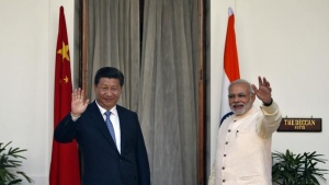 India's Prime Minister Narendra Modi (R) and China's President Xi Jinping wave to the media during a photo opportunity ahead of their meeting at Hyderabad House in New Delhi September 18, 2014. REUTERS/Ahmad Masood