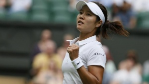 Li Na of China reacts after defeating Paula Kania of Poland in their women's singles tennis match at the Wimbledon Tennis Championships, in London June 23, 2014.          REUTERS/Stefan Wermuth/Files