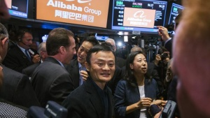 "Alibaba Group Holding Ltd. founder Jack Ma greets traders at the New York Stock Exchange as he celebrates the company's initial public offering (IPO) under the ticker ""BABA"", in New York September 19, 2014. REUTERS/Lucas Jackson"