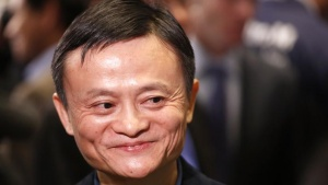 "Alibaba Group Holding Ltd founder Jack Ma reacts at the New York Stock Exchange before his company's initial public offering (IPO) under the ticker ""BABA"" in New York September 19, 2014.       REUTERS/Lucas Jackson"