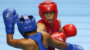 India's Chungneijang Mary Kom Hmangte (red) fights with Kazakhstan's Zhaina Shekerbekova (blue) during their women's fly (48-51kg) boxing match final at the Seonhak Gymnasium during the 2014 REUTERS/Kim Kyung-Hoon