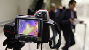 A thermal camera monitors the body temperature of passengers arriving to Tocumen International airport in Panama City October 15, 2014. REUTERS/Rafael Ibarra