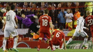 Real Madrid's Cristiano Ronaldo (2nd R) scores the opening goal against Liverpool during their Champions League Group B soccer match at Anfield in Liverpool, northern England October 22, 2014. REUTERS/Phil Noble