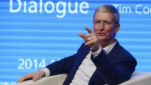 Apple CEO Tim Cook gestures as he speaks at Tsinghua University in Beijing October 23, 2014. REUTERS/China Daily