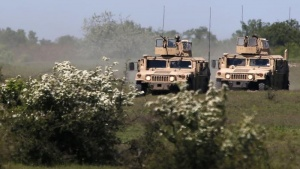 Members of the U.S. 3rd Battalion, 8th Marine Regiment in participate with two Humvee vehicles in the Black Sea Rotational Force 14 - Platinum Eagle military exercise at Babadag training area May 8, 2014. REUTERS/Bogdan Cristel/Files
