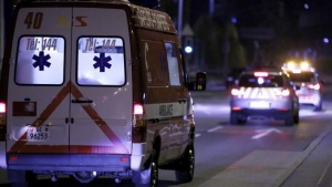 An ambulance carrying Cuban doctor Felix Baez leaves Cointrin airport in Geneva November 21, 2014. REUTERS/Pierre Albouy