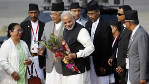 India's Prime Minister Narendra Modi (C) receives a bouquet upon his arrival for the 18th South Asian Association for Regional Cooperation (SAARC) summit in Kathmandu November 25, 2014. REUTERS/Navesh Chitrakar
