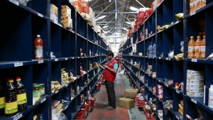 An employee scans a package for an order at a Big Basket warehouse on the outskirts of Mumbai November 4, 2014. REUTERS/Danish Siddiqui