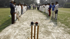 Members of two local cricket teams observe a moment of silence for Australian cricketer Phillip Hughes before their match in Kolkata November 27, 2014.  REUTERS/Rupak De Chowdhuri
