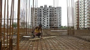 A labourer works at the construction site of a residential complex in Kolkata August 29, 2014. REUTERS/Rupak De Chowdhuri/Files