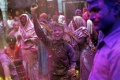 People daubed in colours take part in the Holi celebrations at Vrindavan in Uttar Pradesh March 3, 2015. REUTERS/Ahmad Masood