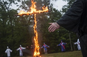 "A tattoo on the knuckles of a Klansman reads ""Love"" as he participates with members of the Nordic Order Knights and the Rebel Brigade Knights, groups that both claim affiliation with the Ku Klux Klan, in a cross lighting ceremony on a fellow member's property in Henry County, Virginia, August 9, 2014. REUTERS/Johnny Milano"