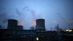 Chimneys of coal-fired power plant are seen next to residential houses in the night in Shijiazhuang, Hebei province, China,  January 28, 2015.   REUTERS/Kim Kyung-Hoon