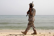 A Saudi border guard patrols near Saudi Arabia's border with Yemen, along a beach on the Red Sea, near Jizan April 8, 2015. REUTERS/Faisal Al Nasser