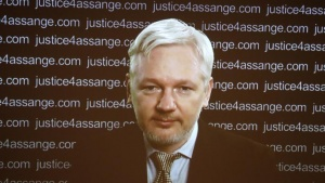 WikiLeaks founder Julian Assange appears on screen via video link during a news conference at the Frontline Club in London, Britain February 5, 2016. REUTERS/Neil Hall