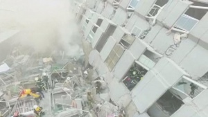 Rescue workers search for survivors at a 17-storey building which collapsed during an earthquake in Tainan, southern Taiwan, in this still image taken from video shot on February 6, 2016.   REUTERS/CTI via Reuters TV