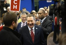 Republican presidential candidate businessman John Kasich smiles in the spin room after the Republican presidential candidates debate sponsored by ABC News at Saint Anselm College in Manchester, New Hampshire February 6, 2016.     REUTERS/Rick Wilking