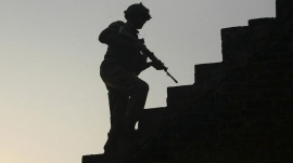 An Indian army soldier climbs up stairs to take his position on the rooftop of a residential house outside the Indian Air Force (IAF) base at Pathankot in Punjab, India, January 3, 2016. REUTERS/Mukesh Gupta/Files