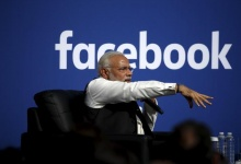 Indian Prime Minister Narendra Modi gestures as he speaks on stage during a town hall at Facebook's headquarters in Menlo Park, California September 27, 2015. REUTERS/Stephen Lam