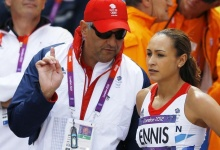 Britain's Jessica Ennis talks to her coach Toni Minichiello during her women's heptathlon high jump Group A event at the London 2012 Olympic Games at the Olympic Stadium August 3, 2012. REUTERS/Phil Noble