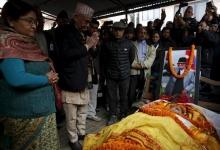 Nepalese Prime Minister Khadga Prashad Sharma Oli, also known as KP Oli, pays his respects to the late former Prime Minister Sushil Koirala in Kathmandu, Nepal, February 9, 2016. REUTERS/Navesh Chitrakar