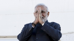 India's Prime Minister Narendra Modi gestures while disembarking his plane after arriving at the Ottawa International Airport in this April 14, 2015 file photo. REUTERS/Chris Wattie/Files