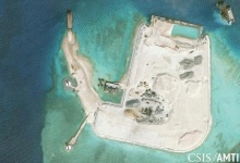 The artificial island at the southern end of Mischief Reef showing a newly-built seawall on its north side and a completed dock are shown in this Center for Strategic and International Studies (CSIS) Asia Maritime Transparency Initiative January 8, 2016 satellite image released to Reuters on January 15, 2016. REUTERS/CSIS Asia Maritime Transparency Initiative/Digital Globe/Handout via Reuters