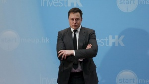 Tesla Chief Executive Elon Musk stands on the podium as he attends a forum on startups in Hong Kong, China in this January 26, 2016, file photo.  REUTERS/Bobby Yip/Files
