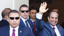 Egyptian President Abdel Fattah al-Sisi (R) waves during the opening ceremony of the new Suez Canal, in Ismailia, Egypt, August 6, 2015. REUTERS/Amr Abdallah Dalsh