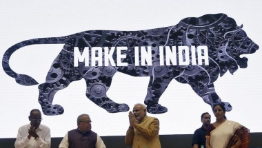Prime Minister Narendra Modi (C) gestures as other ministers look on during the launch of 'Make in India' campaign in New Delhi September 25, 2014. REUTERS/Adnan Abidi/Files