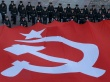 Cadets of the Russian Emergencies Ministry hold a giant replica of the so-called Victory Standard at the Poklonnaya Gora War Memorial Park, in Moscow, Russia, February 4, 2016. The banner, measuring more than a thousand square meters, is the largest replica of the so-called Victory Standard in Russia, according to organizers. REUTERS/Sergei Karpukhin