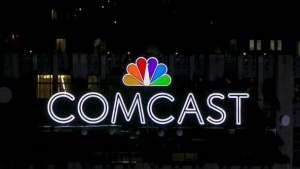 The NBC and Comcast logo are displayed on top of 30 Rockefeller Plaza, formerly known as the GE building, in midtown Manhattan in New York July 1, 2015. REUTERS/Brendan McDermid/Files