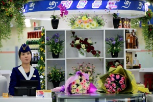 A vendor waits for customers at the shop inside the international airport in Pyongyang, North Korea May 3, 2016. REUTERS/Damir Sagolj