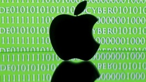 A 3D printed Apple logo is seen in front of a displayed cyber code in this illustration taken February 26, 2016. REUTERS/Dado Ruvic/Illustration