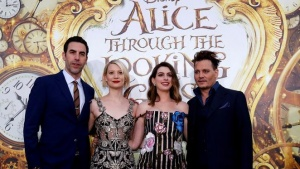 "Cast members (L-R) Sacha Baron Cohen, Mia Wasikowska, Anne Hathaway and Johnny Depp pose at the premiere of ""Alice Through the Looking Glass"" at El Capitan theatre in Hollywood, U.S., May 23, 2016. REUTERS/Mario Anzuoni"