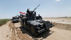 Iraqi security forces military vehicles are seen near Falluja, Iraq, May 31, 2016.  REUTERS/Thaier Al-Sudani