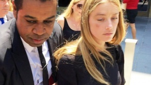 Actress Amber Heard leaves the Superior Court of Los Angeles in Los Angeles, California, U.S. May 27, 2016, with what appears to be a bruise on her right cheek after obtaining a restraining order against husband Johnny Depp in this still image from video. REUTERS/Rollo Ross