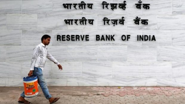 A man walks past the Reserve Bank of India (RBI) head office in Mumbai, India, June 7, 2016. REUTERS/Danish Siddiqui