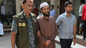 Police officers in Dhaka detain Abdul Haque, a member of Jamaat-e-Islami, Bangladesh's biggest religion-based party, on suspicion he was involved in Islamic State propaganda, November 25, 2015. REUTERS/Ashikur Rahman/Files