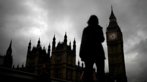 A woman walks past the Houses of Parliament and the Big Ben clock tower, on the day of the EU referendum, in central London, Britain June 23, 2016.       REUTERS/Phil Noble