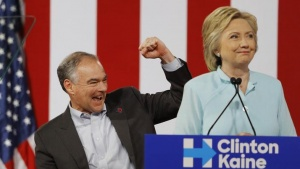 Democratic U.S vice presidential candidate Senator Tim Kaine (D-VA) pumps his fist after Democratic U.S. presidential candidate Hillary Clinton (R) publicly introduced him as her vice presidential running-mate during a campaign rally in Miami, Florida, U.S. July 23, 2016. REUTERS/Scott Audette