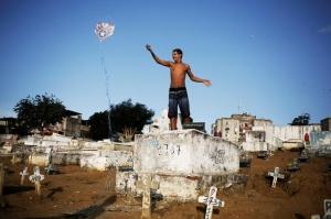 A man flies his kite in a cemetery in the Vila Operaria Favela of Rio de Janeiro, Brazil, June 25, 2016. REUTERS/Nacho Doce